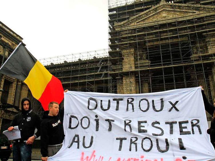 People take part in a demonstration against Belgian paedophile killer Marc Dutroux