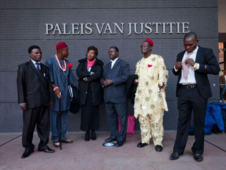 The plaintiffs with the lawyers in front of The Hague courthouse