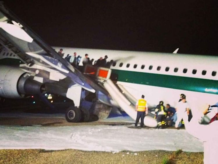 A plane has skidded off the runway at Rome's Fiumicino airport