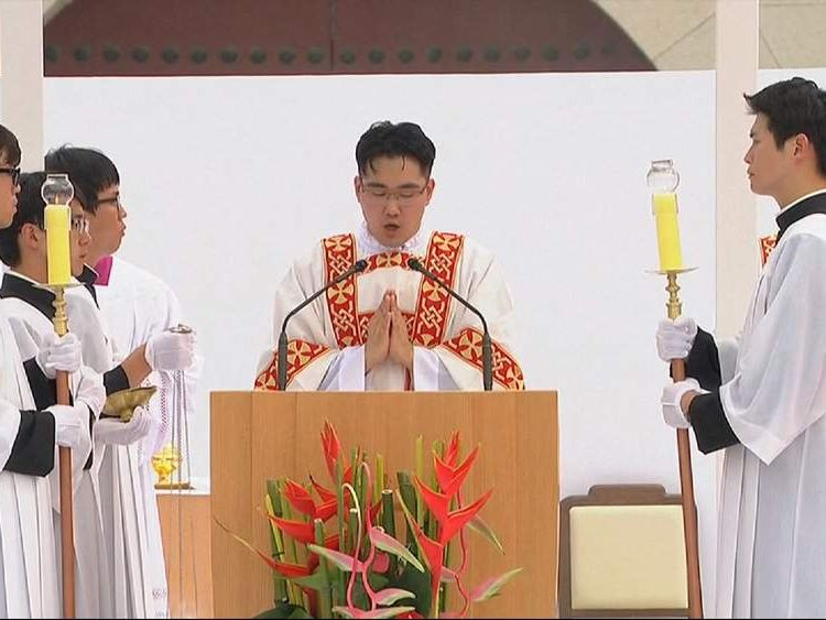 Local priests take part in the mass held by Pope Francis