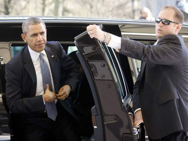 President Barack Obama leaves the presidential limo upon arriving to attend the Nuclear Security summit (NSS) in The Hague
