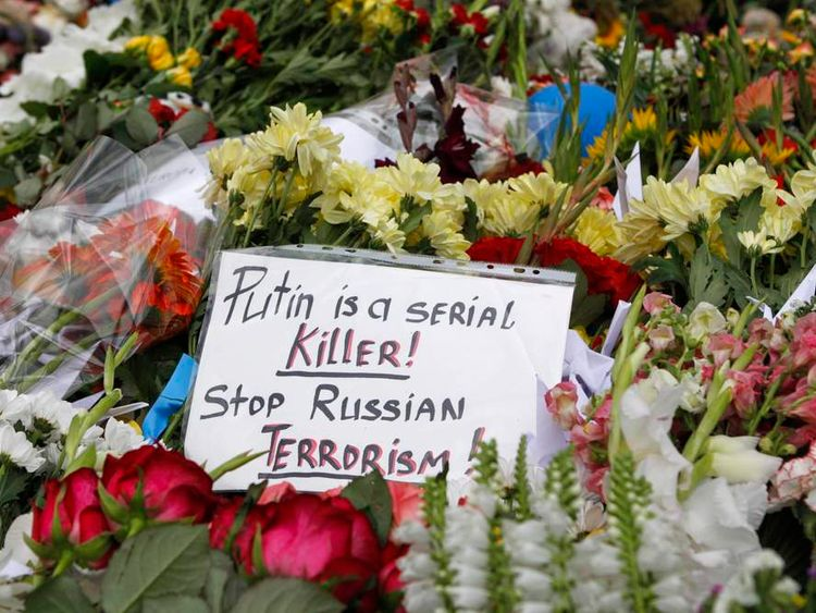 Flowers and messages left by local residents for victims of Malaysia Airlines Flight MH17 are pictured outside the Dutch embassy in Kiev