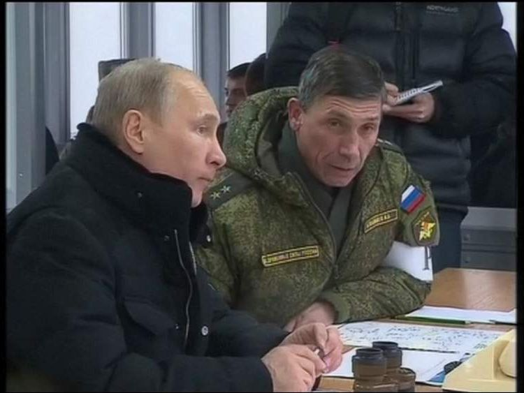 Vladimir Putin watches a live firing military exercise