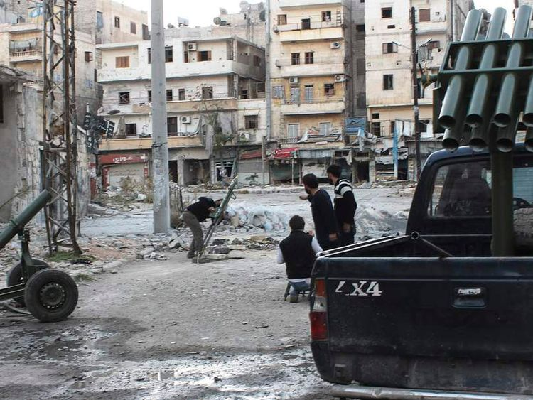 Free Syrian Army fighters prepare to launch a rocket towards forces loyal to President Bashar al-Assad in the Salah al-Din neighbourhood in central Aleppo