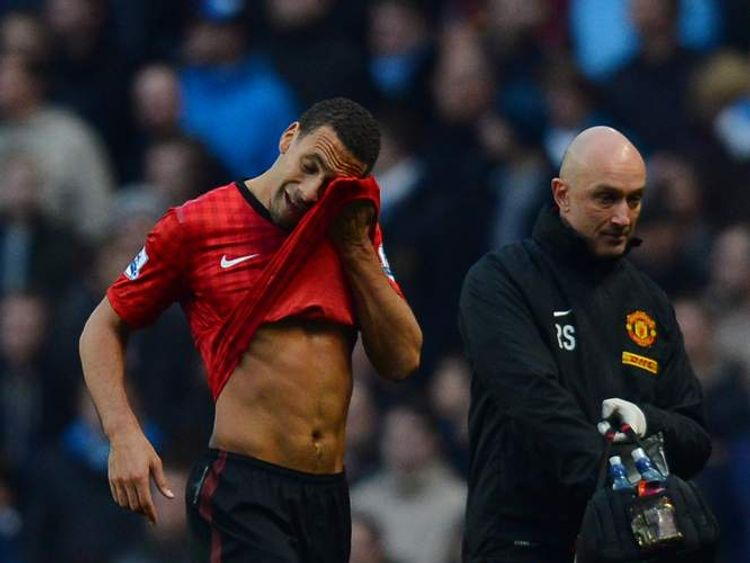 Rio Ferdinand after being struck by a coin