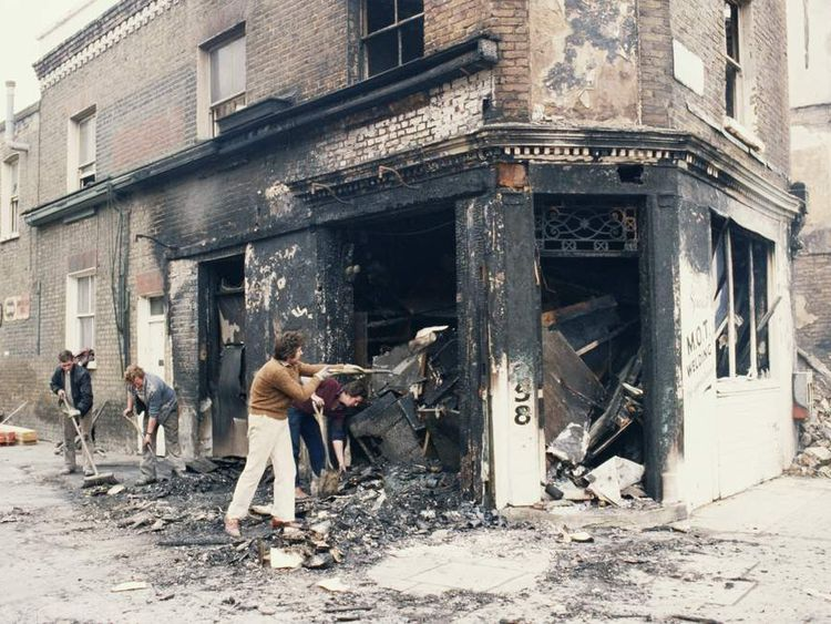 Workers clearing debris from a burnt-out welding shop in Railton Road, Brixton, south London, after the first Brixton riot, 13th April 1981. (Photo by Keystone/Hulton Archive/Getty Images)