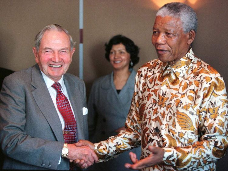 MANDELA AND ROCKEFELLER MEET AT BUSINESS BREAKFAST.