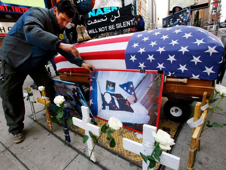 Father of slain US Marine takes part in an anti-war demonstration in Times Square in New York City