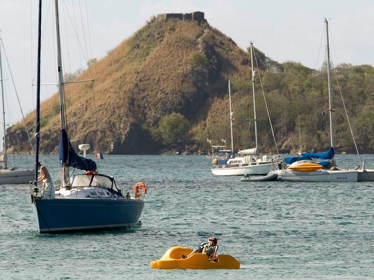 Tourists use a pedalo in Rodney Bay, St Lucia