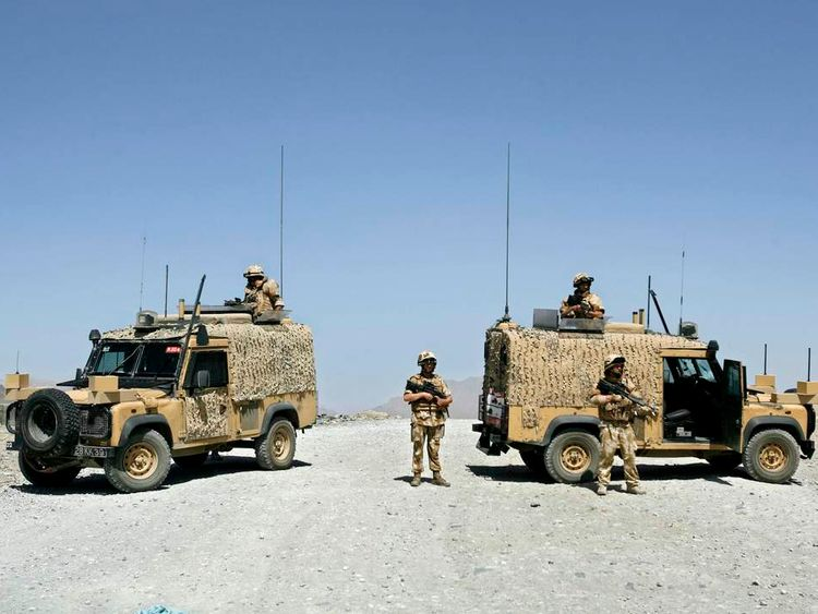 British soldiers block the road leading to a suicide blast site outside Kabul