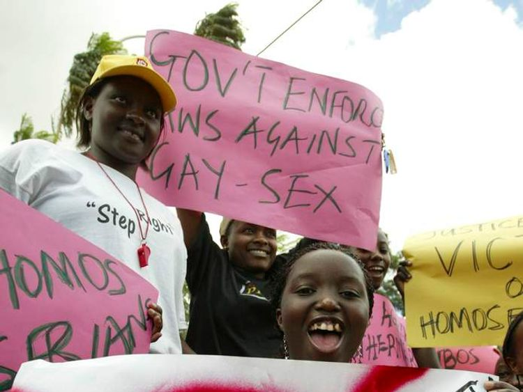 Members of religious groups campaigning against homosexuality hold placards during a rally in Kampala