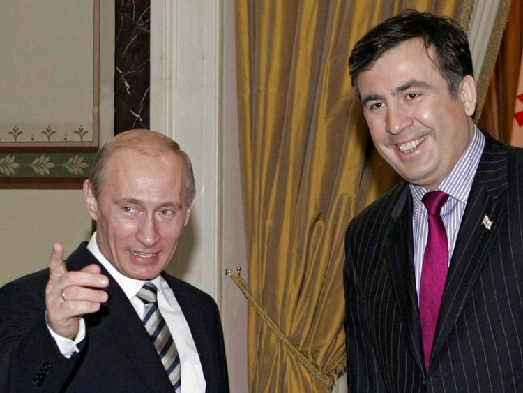Russia's President Vladimir Putin meets his Georgian counterpart Mikhail Saakashvili during an informal CIS summit in Moscow