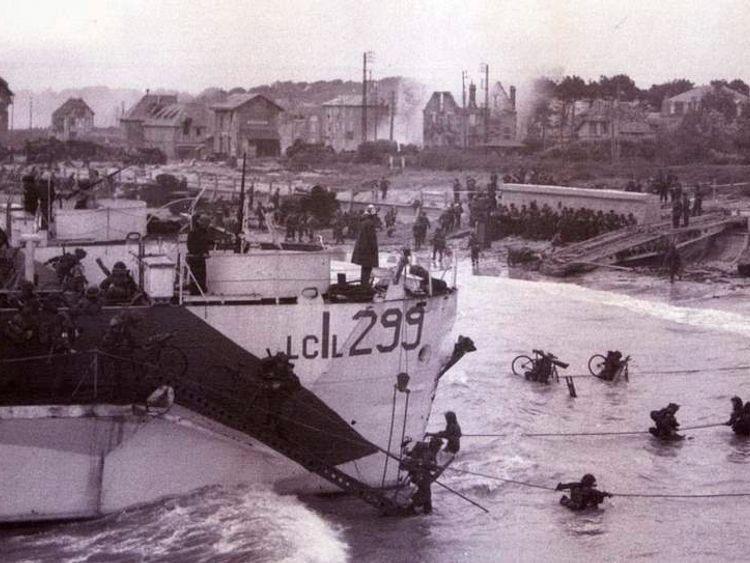 Troops wading ashore after landing in the D-Day invasion at Bernieres-sur-Mer