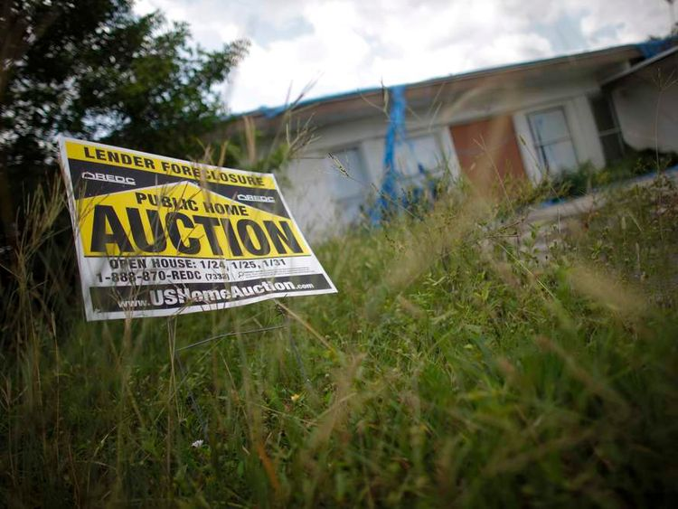 An auction sign for a property in Miami Gardens