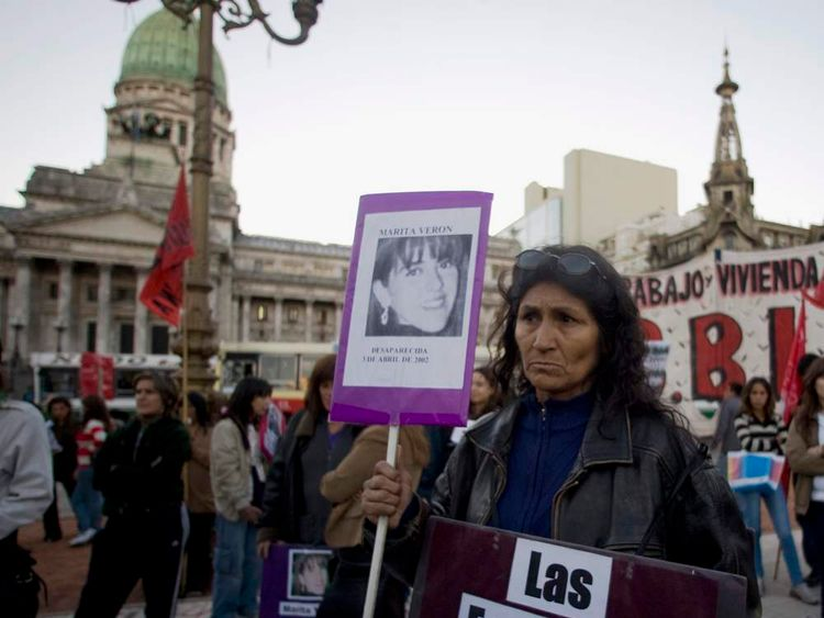 A woman holds a picture of Maria de los Angeles Veron as human rights activists gather in front of the Congress building in Buenos Aires