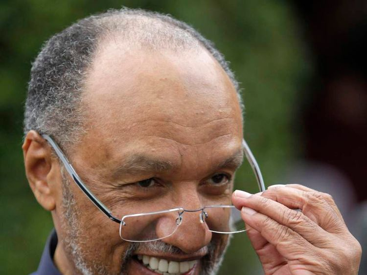 Mohamed bin Hammam, president of the Asian Football Federation, puts on his glasses at a lunch event in Ypacarai