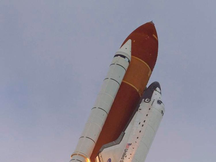 The space shuttle Endeavour lifts off