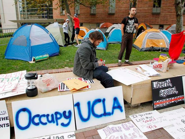 UCLA students create demonstration signs outside their tents at the site of Occupy UCLA at the UCLA campus in Los Angeles