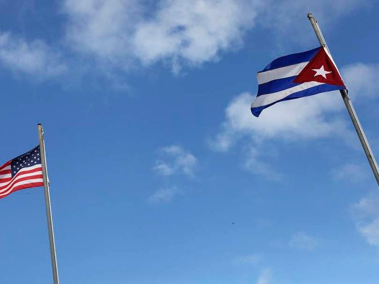 The flags of the United States and Cuba are seen flying in the Little Havana neighborhood of Miami, Florida