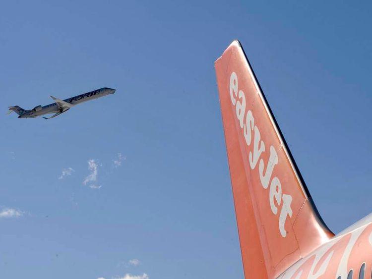 Adria Arway's plane takes off near tail of Easy jet on Ljubljana's airport Brnik