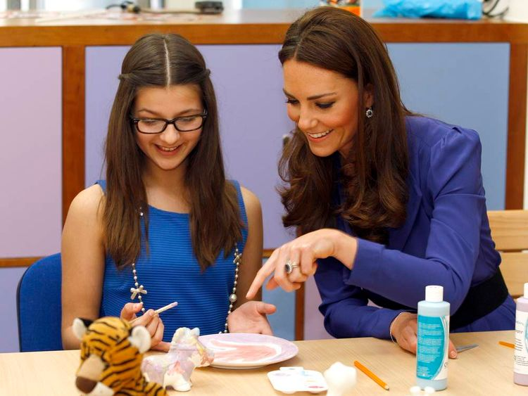 Kate sits next to Brooke Jennings in an art class during a visit to The Treehouse