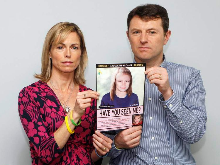 Kate and Gerry McCann pose with a computer generated image of how their missing daughter Madeleine might look now, during a news conference in London