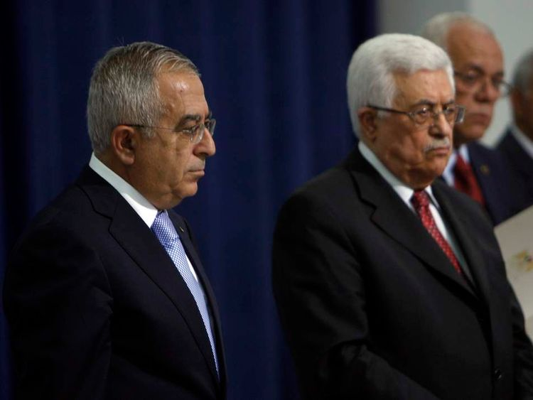 Salam Fayyad stands next with Mahmoud Abbas
