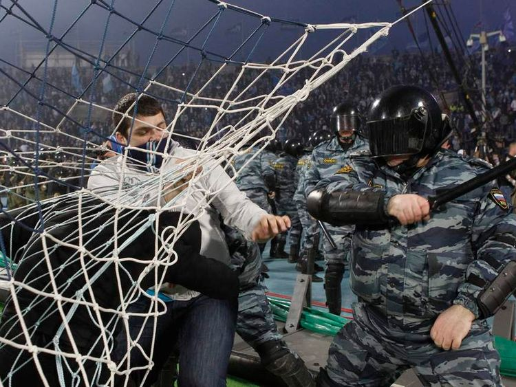 Fans of Zenit St. Petersburg soccer team fight with riot police after the Russian Premier League match  between Zenit St. Petersburg and Dinamo Moscow at the Petrovsky stadium in St. Petersburg