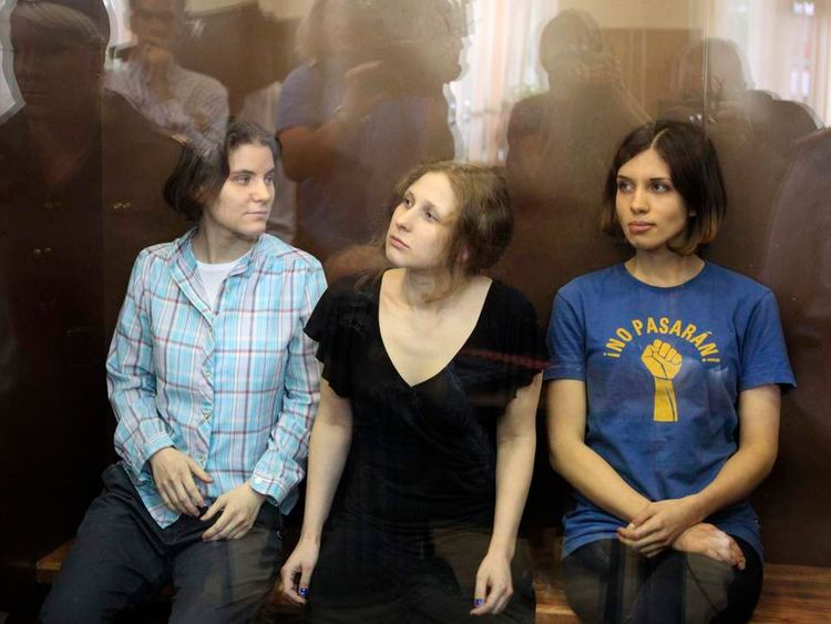"Members of the female punk band ""Pussy Riot"" (R-L) Nadezhda Tolokonnikova, Maria Alyokhina and Yekaterina Samutsevich sit in a glass-walled cage during a court hearing in Moscow, August 17, 2012"