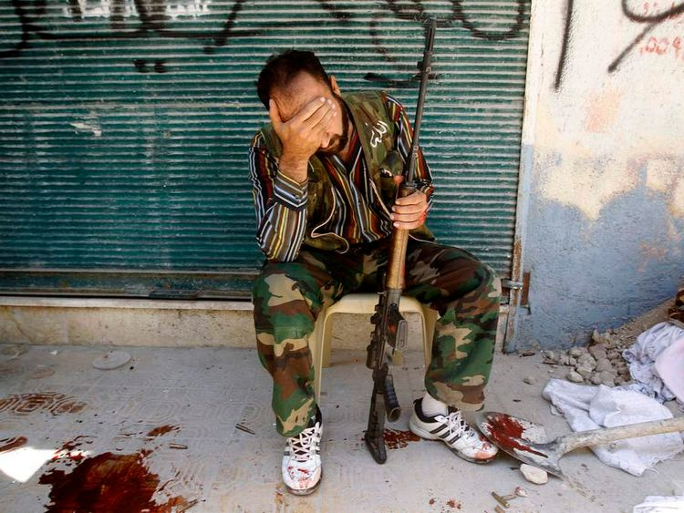A Syrian rebel mourns after his friend was shot in Aleppo