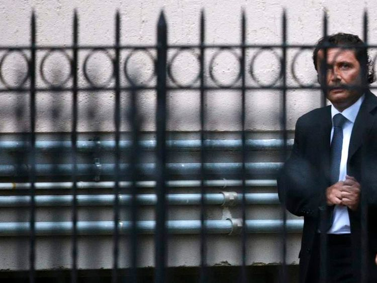 The captain of the Costa Concordia Francesco Schettino leaves at the end of the preliminary hearings in Grosseto