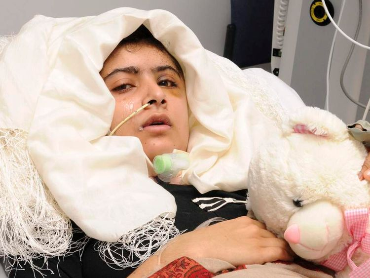 Malala Yousufzai is seen recuperating at the The Queen Elizabeth Hospital in Birmingham