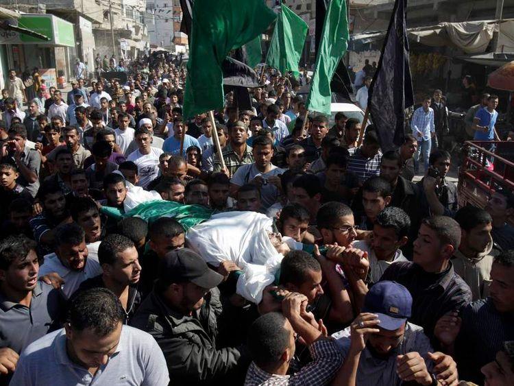 Palestinians carry the body of Hamas militant Suliman al-Garah