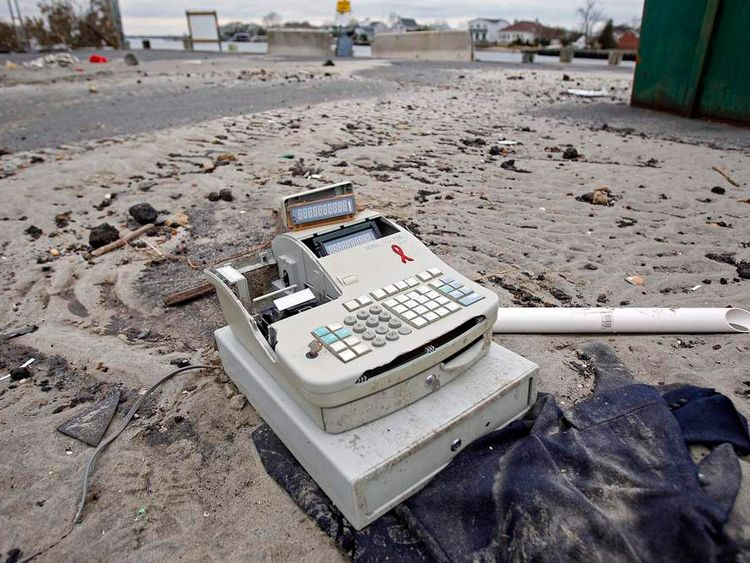 A cash register is seem among other debris following Hurricane Sandy in Sea Bright, New Jersey, November 1, 2012.