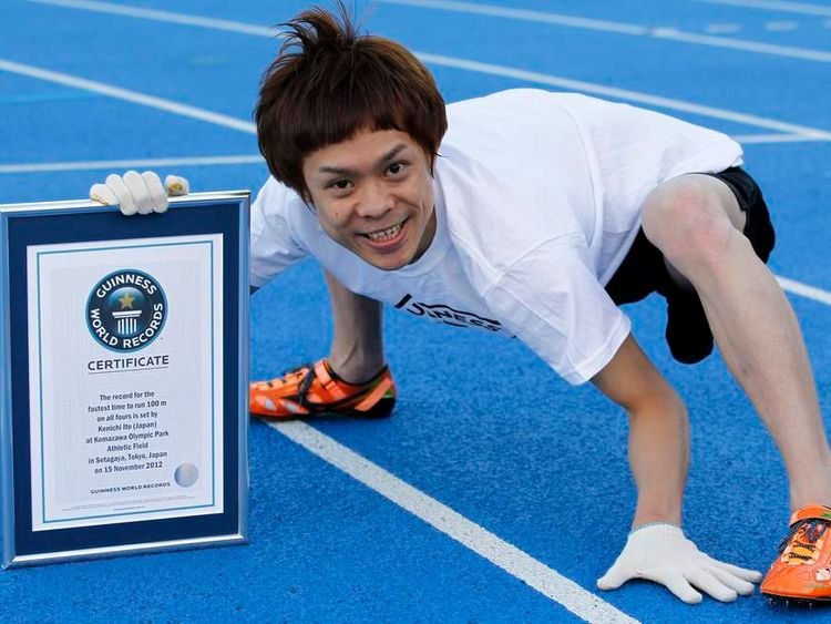 "Kenichi Ito, known as the ""world's fastest man on four legs"", poses with his new Guinness World Records certification for the 100-metre, in Tokyo November 15, 2012."