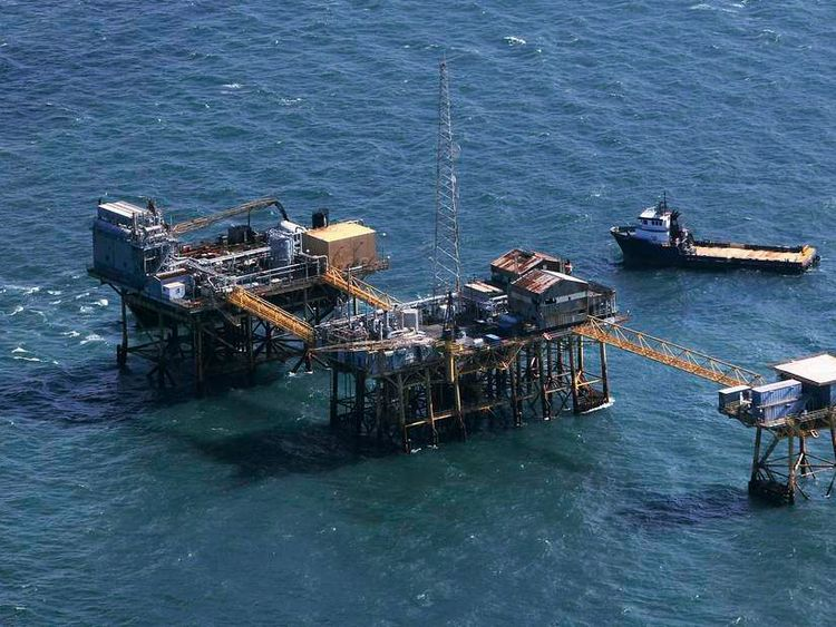 Rescue crew surrounds an oil platform which exploded early this morning in the Gulf of Mexico, off the coast of Louisiana, November 16, 2012.