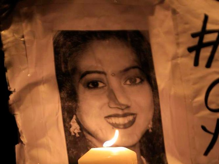 A woman holds a candle during a vigil in memory of Savita Halappanavar and in support of changes to abortion law in Dublin November 17, 2012.