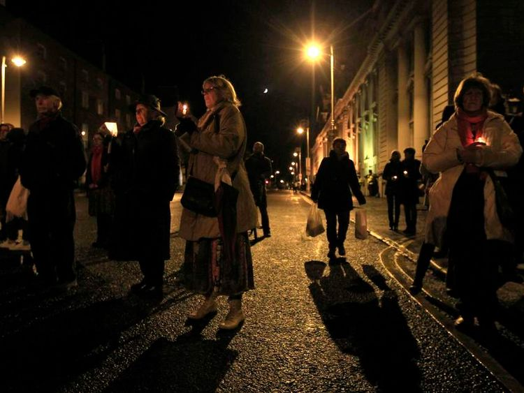 People hold candles during a vigil in memory of Savita Halappanavar and in support of changes to abortion law in Dublin November 17, 2012.