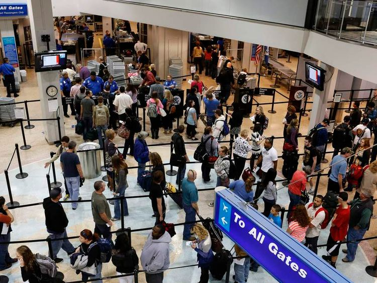 Passengers wait in a security line a day before the annual Thanksgiving Day holiday at the Salt Lake City international airport in Salt Lake City