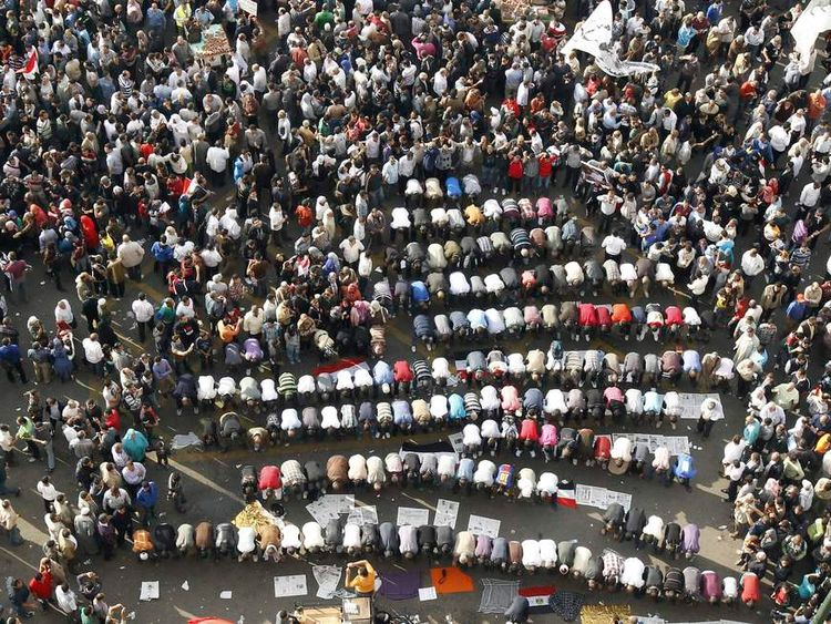 Protesters pray as they gather at Tahrir square in Cairo