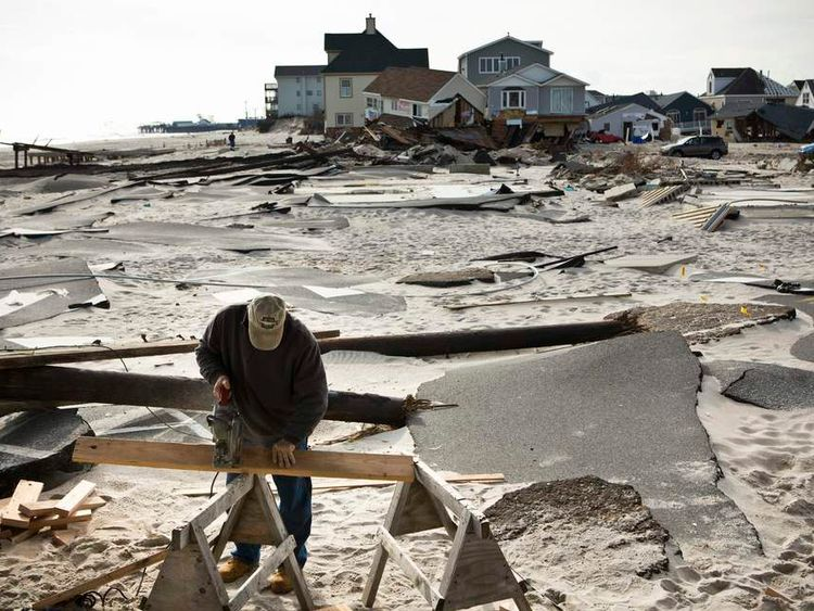 Lynch, a contractor, cuts lumber while repairing a home he built 23 years ago that was damaged by Hurricane Sandy, in the Ortley Beach area of Toms River, New Jersey