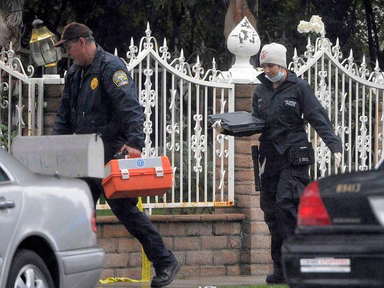 Los Angeles police investigators outside the crime scene of a single-family home in Northridge, California