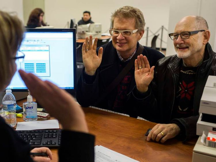 Two Washington residents obtain their marriage license in Seattle, Washington