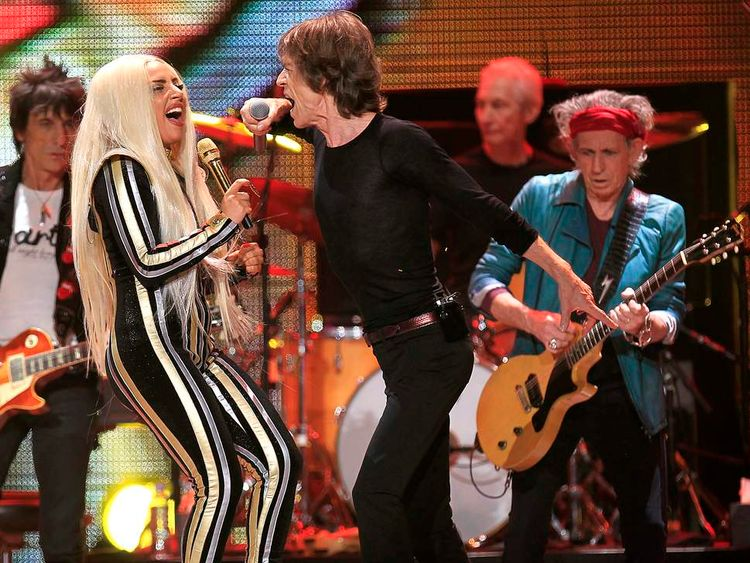 """The Rolling Stones and Lady Gaga perform onstage during the Rolling Stones final concert of their """"50 and Counting Tour"""" in Newark"""