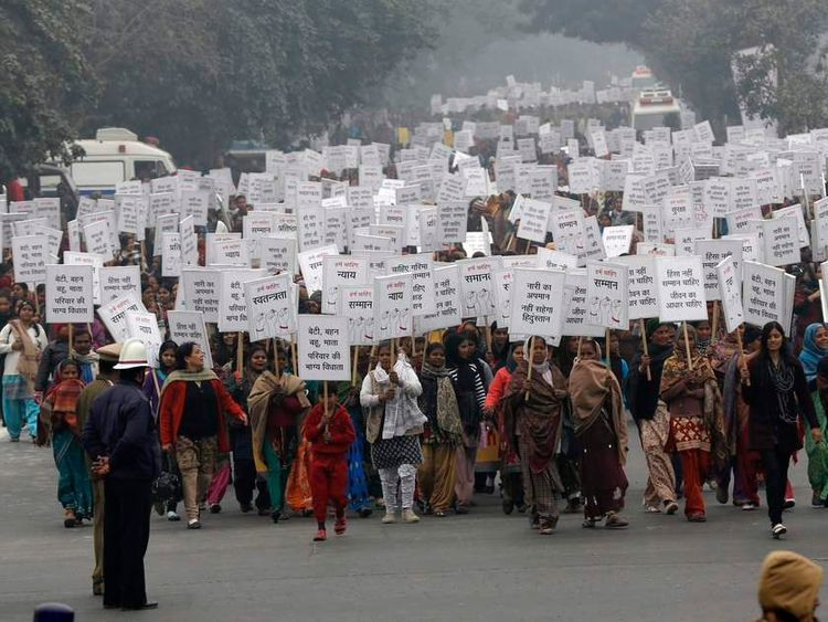 Women hold placards as they march during a rally following the gang rape of a 23-year-old woman in Delhi