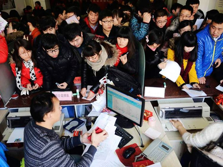 Young couples wait for their marriage certificates at a civil affairs branch office in Qingdao
