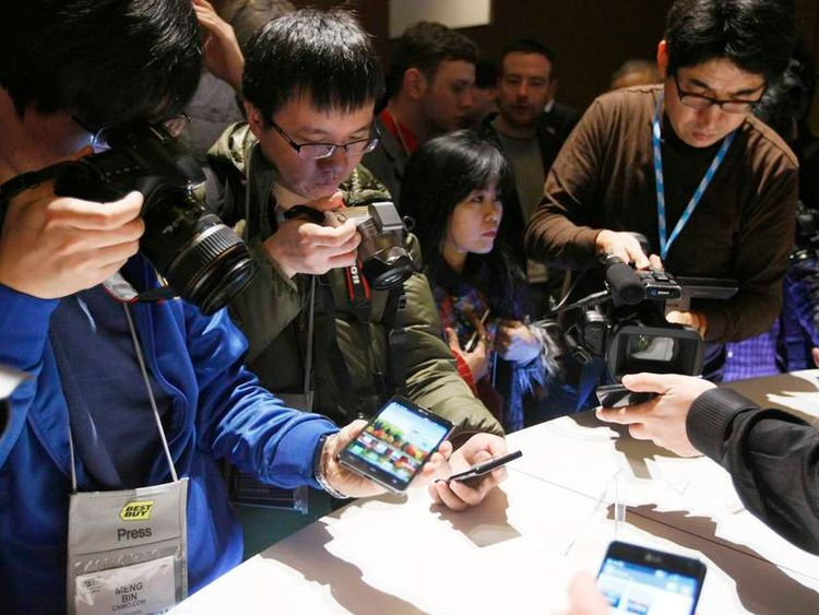 Journalists shoot pictures and videos of new LG smartphones at the Consumer Electronics Show (CES) in Las Vegas