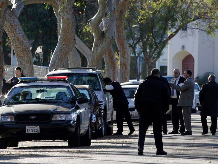 Los Angeles Police detective looks into car believed to belong to robbery suspect in Westchester area of Los Angeles