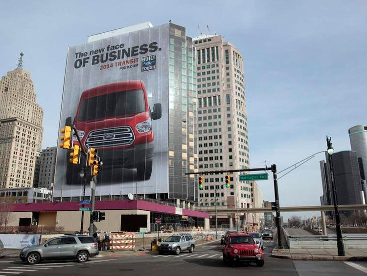 A building in downtown is covered with an auto advertisement in advance of media preview days of the North American International Auto show in Detroit
