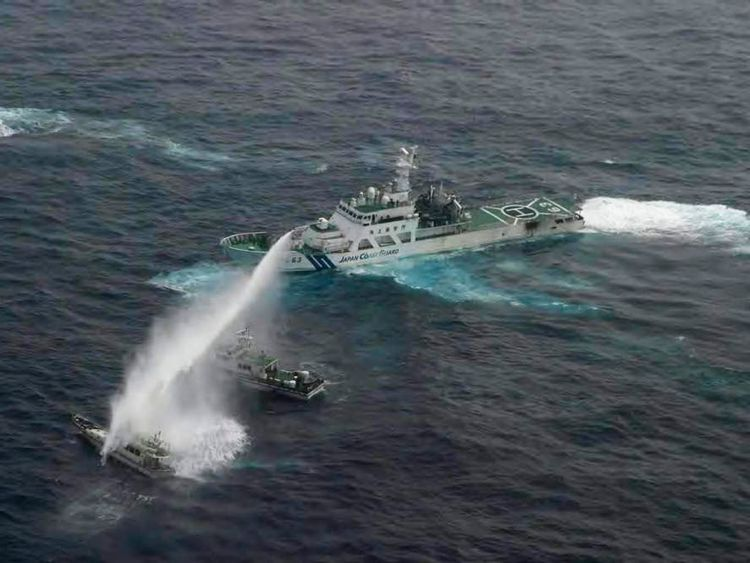 Aerial view shows Japan Coast Guard patrol ship spraying water at fishing boat that was carrying Taiwanese activists in East China Sea